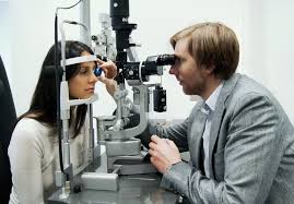 an ophthalmologist doing what they do best